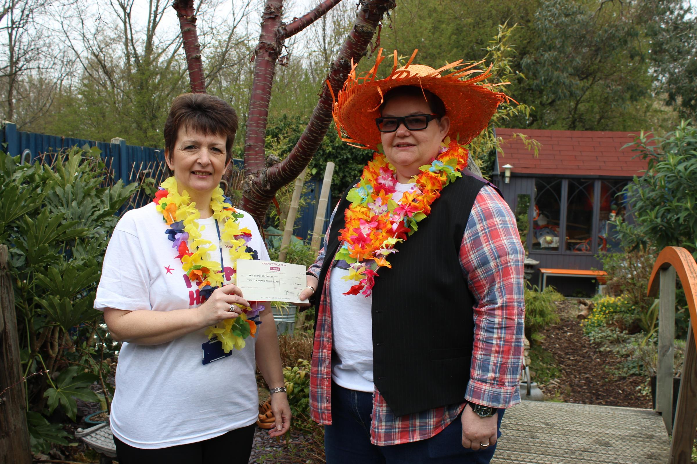 Winner – Sarah Greensides collects her cheque for £3.000 from Carmel Hudson