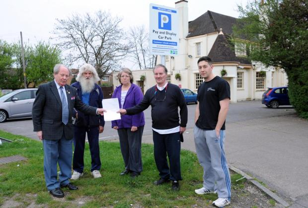 Pub parking charges clog road with cars