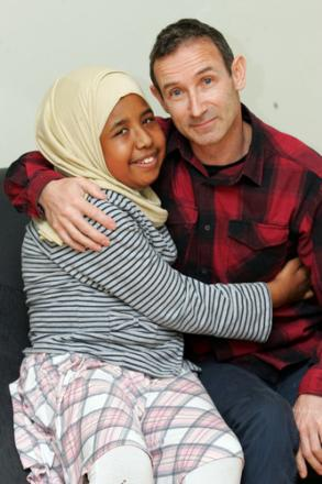 Thank you – teacher Ray Coe gets a hug from Alya Sheikh