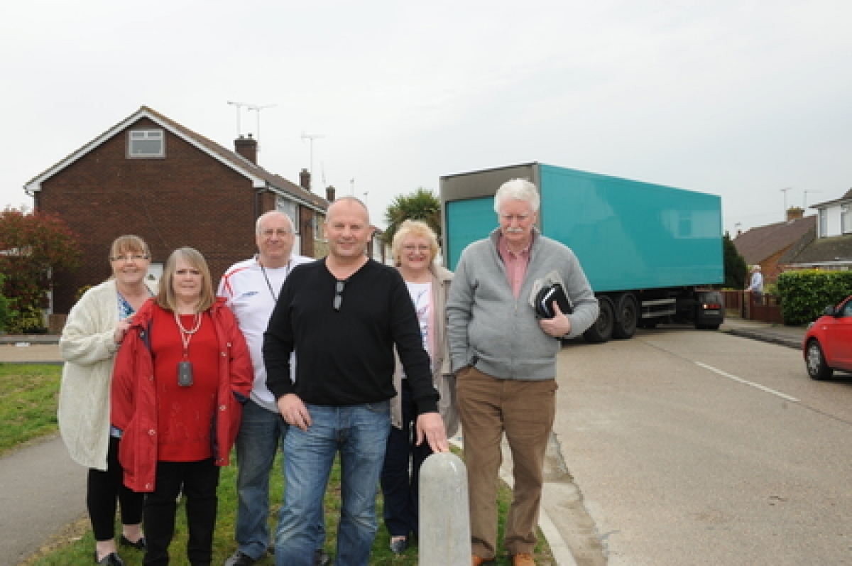 Caught in the act – as Echo photographer Luan Marshall took pictures of councillor Peter May, front, and campaigners, a lorry mounted the pavement behind them