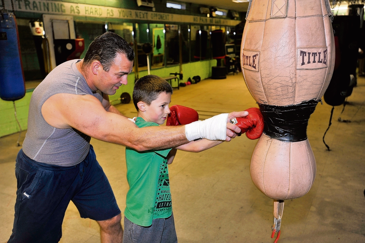 Mark Quirey takes time out from training to coach his nephew Harrison Quirey at Berry Boys