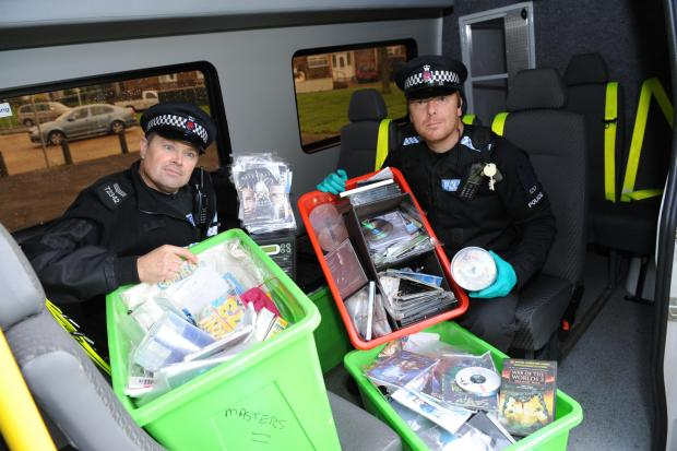 Haul – Sgt Paul Costin and PC Wynn Sharp with the DVDs and equipment seized at Wiggins's house