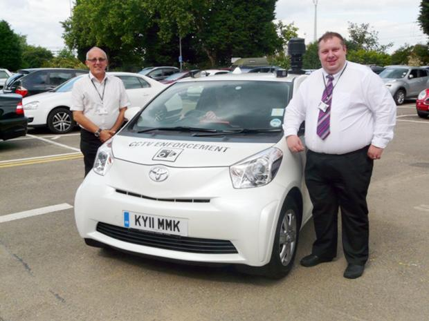 Echo: Derek Kenyon (left) in his days as spy car chief, with councillor Tony Cox