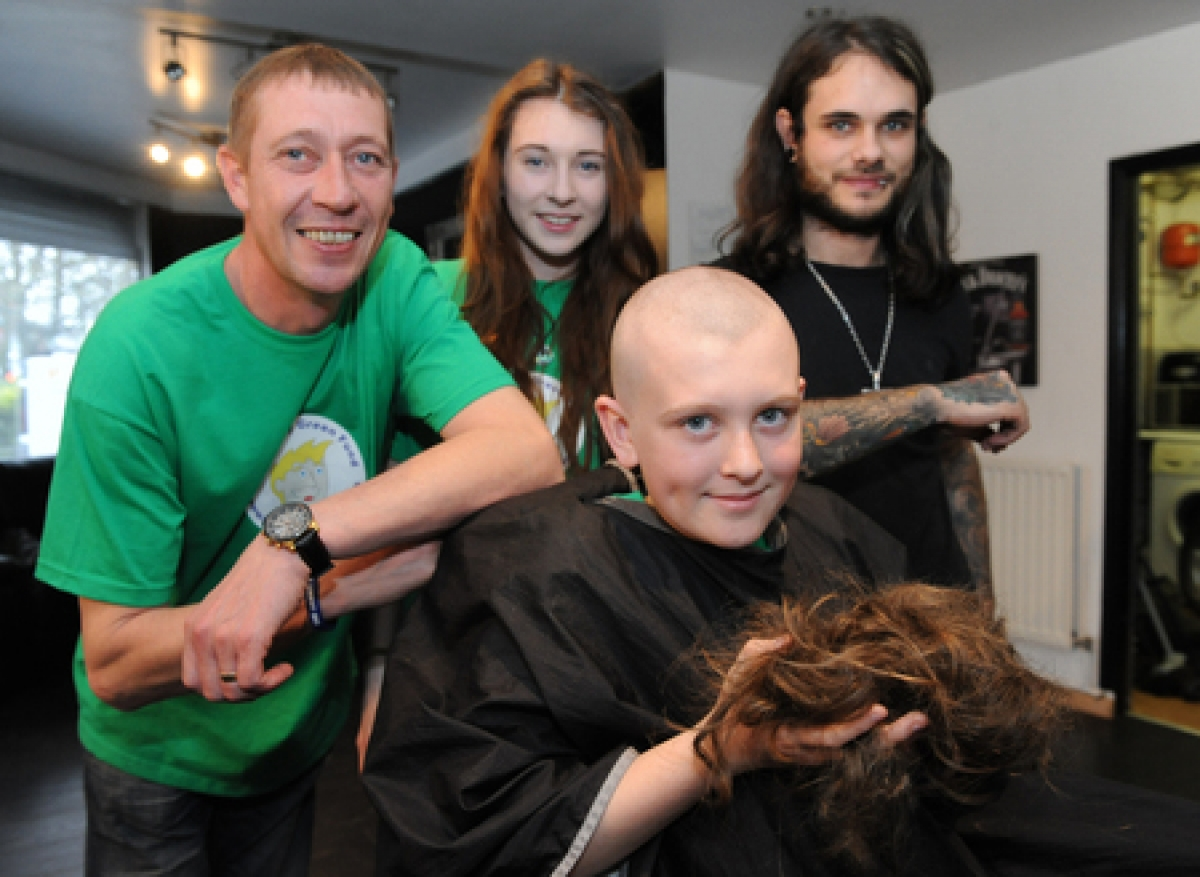 Schoolboy has head shaved for charity