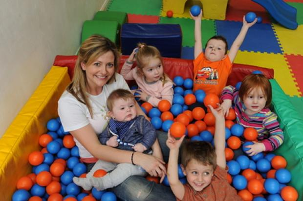 Having a ball – Claire Ostermeyer celebrates her nominations in a ball pool with some of the youngstersin her Safari Tots Toddler Group