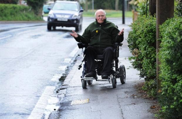 Echo: Concern - Mr Bull in his wheelchair in Rectory Road, Hadleigh