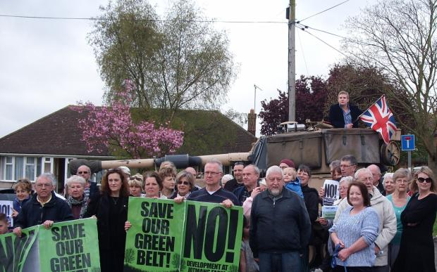 Firepower – the tank, with councillor Andrew Sheldon on board, backs up residents, councillors and Castle Point MP Rebecca Harris, fifth from left, at the threatened green belt site