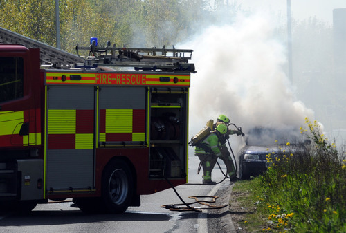 Firefighters tackle car fire in Canvey Way