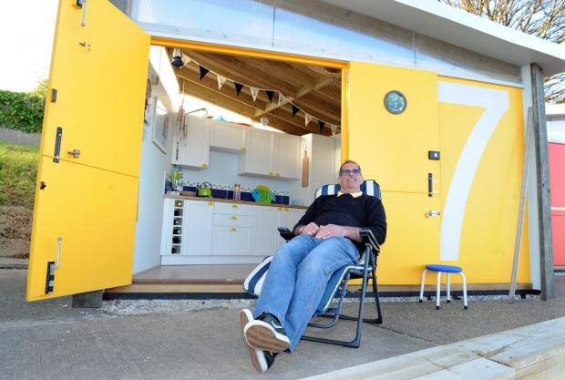 Calm before the storm – Trevor Smith relaxes at his beach hut earlier this month