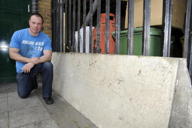 Risk to the public – construction worker Nigel Low with asbestos dumped outside the