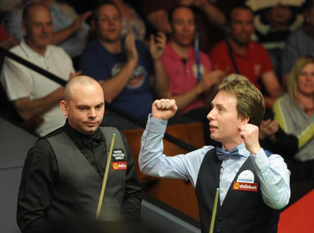 A disappointed Stuart Bingham watches as Ken Doherty celebrates his win