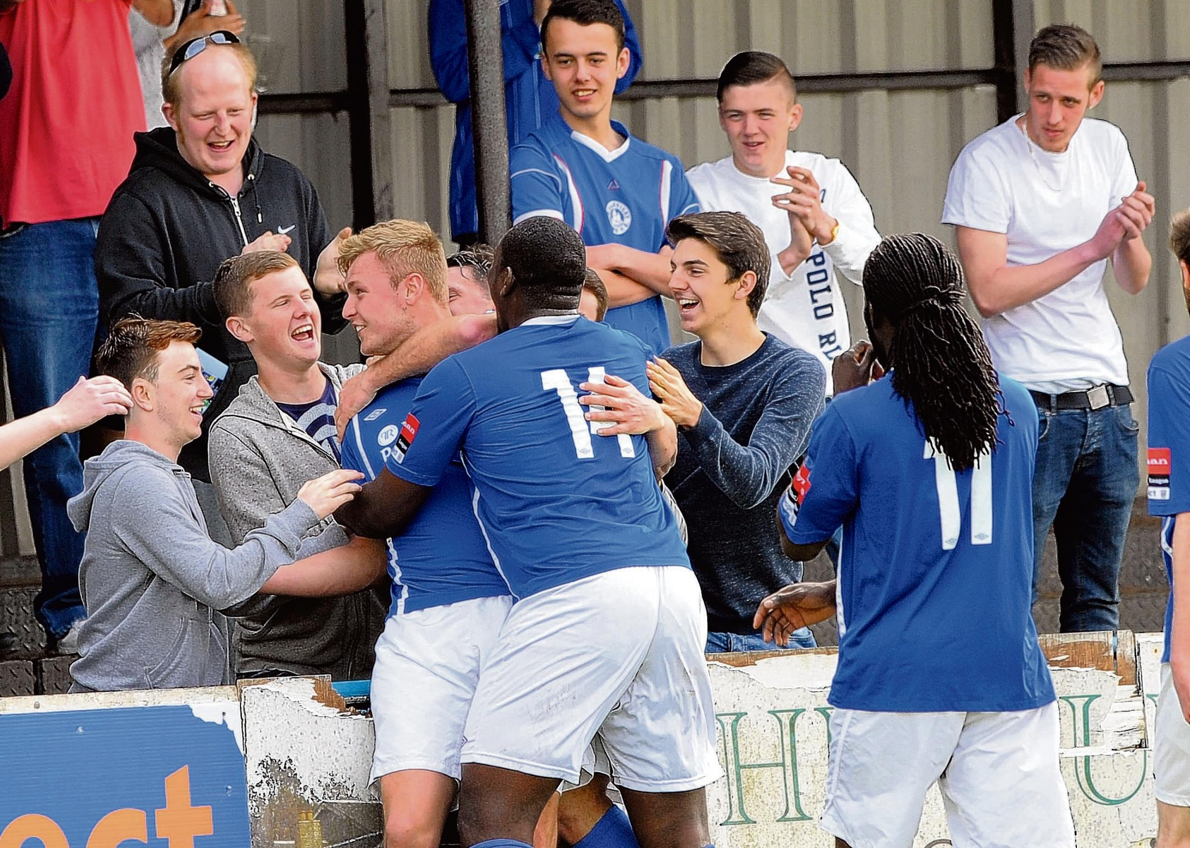 Billericay's Ryan Scott celebrates his goal with the fans