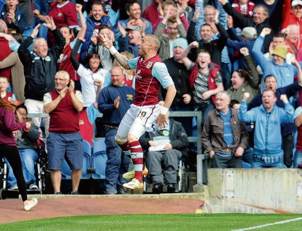 Heading to the promised land – Michael Kightly celebrates scoring against Wigan in the 2-0 win that sealed Burnley's promotion