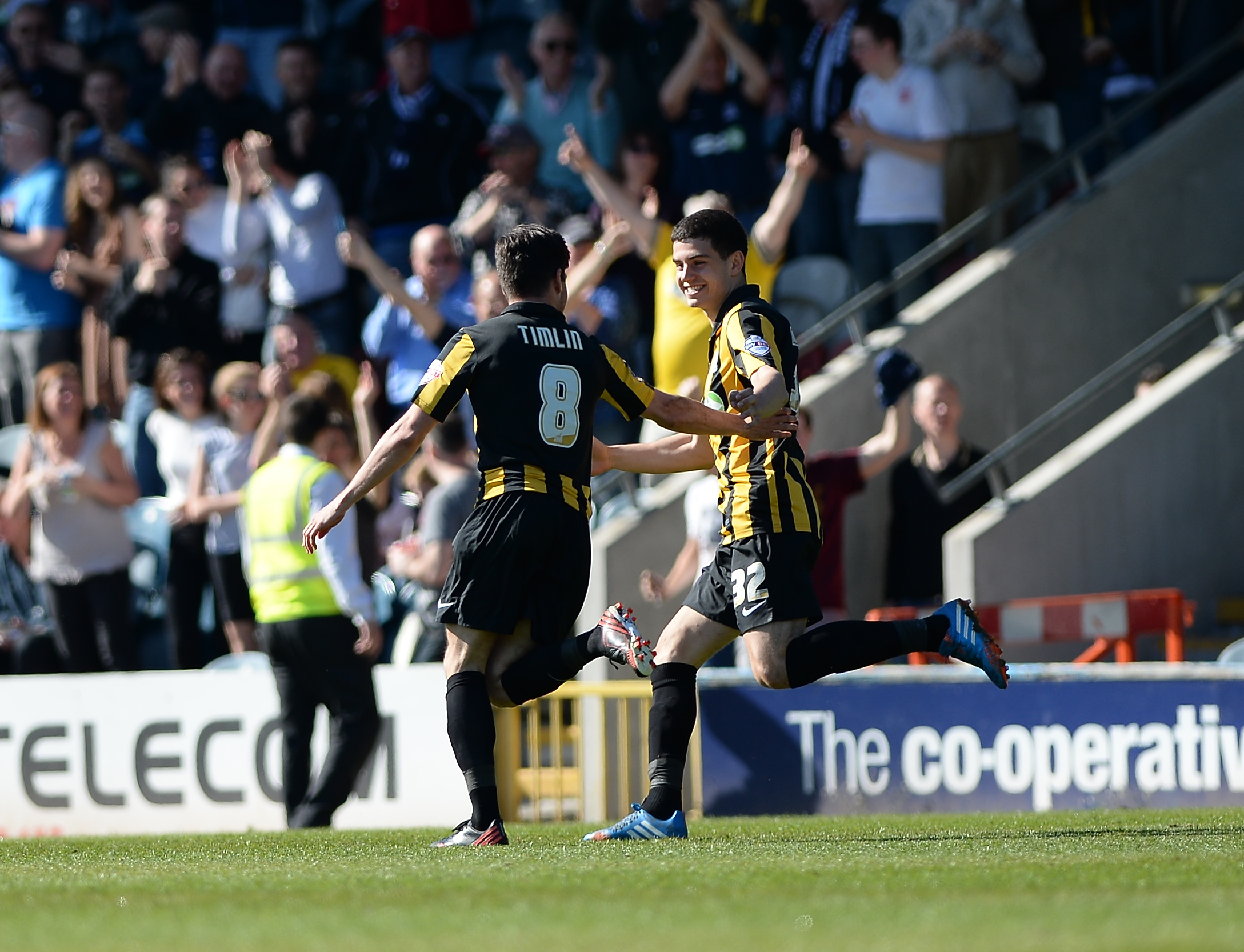 Michael Timlin celebrates with John Egan after scoring at Rochdale