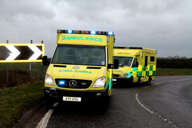 A woman has sustained serious injuries after being trapped in her car