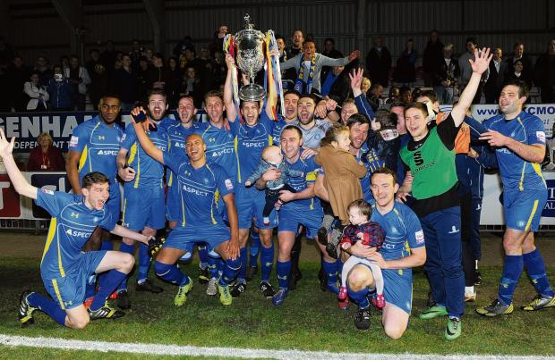 Echo: What a night - Concord's players, including Tony Stokes (centre with son) celebrate with the Essex Senior Cup