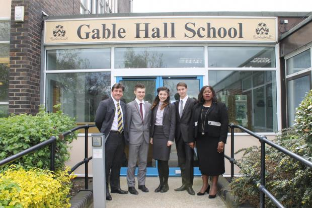 Echo: Stephen Metcalfe with senior pupils and headteacher Dr Sofina Asong
