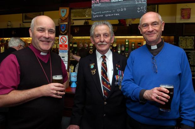 Enjoying a pint – the Rt Rev Stephen Cottrell with veteran Dennis Ward and the canon of St John's Church, Southend, Stephen Burdett