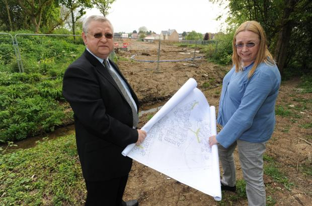 Drainage concerns – John and Christine Mason with plans for the site in Hawkwell