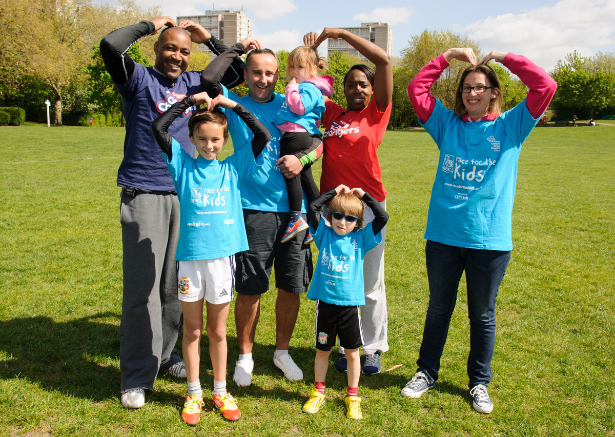Taking a breather – Olympic stars Darren Campbell and Jeanette Kwakye with Hayden, Giles, Lucy, Charlie and Ellie Curtis, from Rayleigh, at the training session in Battersea Park