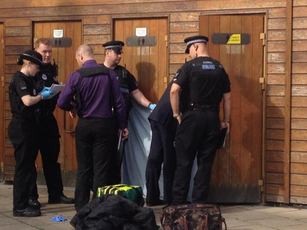 Police officers and paramedics at the Pitman's Close toilets