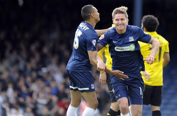 Well done — Barry Corr is congratulated on scoring against Burton Albion last Saturday. Now he will be looking to beat the Brewers again over two legs to reach a Wembley final again