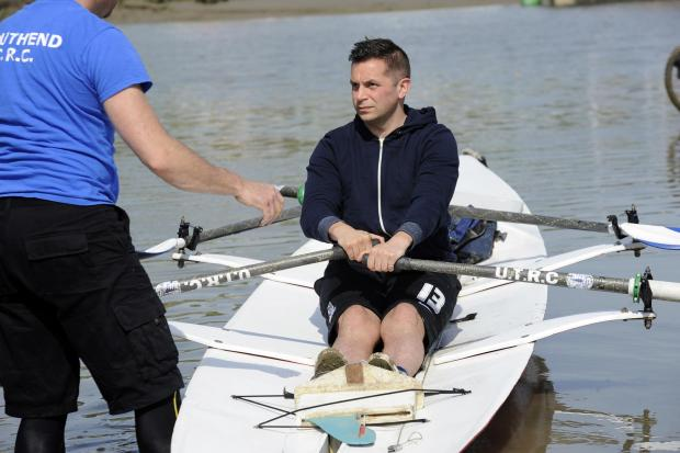 All aboard - Echo reporter Chris Phillips (right) gets ready to row with Gerry White