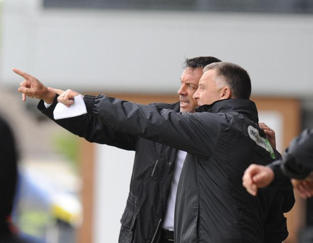 Phil Brown and Dave Penney talk tactics on the sideline as they try to plan a way back into the game for their Southend side