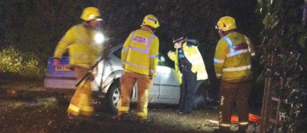 Aftermath – emergency services check out one of the crashed cars