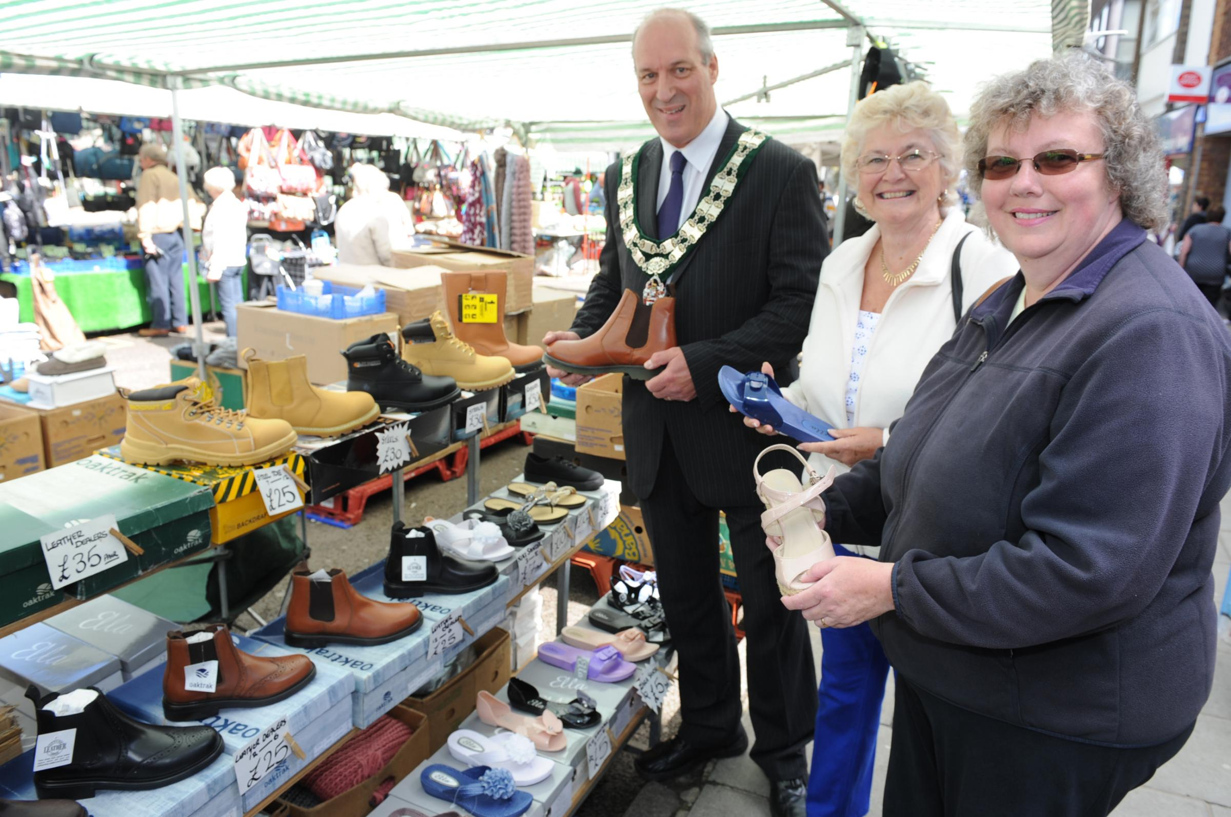 Shoe stall – Eddie Dray, Rayleigh in Bloom chairman Margaret Spencer and environment chairman Cheryl Roe look for bargain footwear