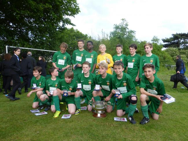 Hands on the cup – the Year 7 team with their trophy