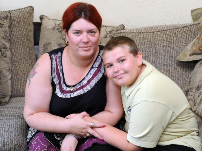 Young life saver – Brandon Mildren with his mum, Tania