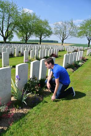 Respect – Oliver De'Ath at the grave of his great uncle William Bygraves, in Belgium