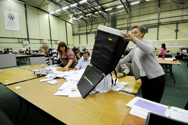 Votes poured out of a ballot box