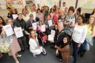 Students from the college with certificates they received for completing a reading challenge