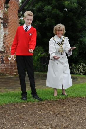 Councillor Barbara Wilkins, chairman of Rochford District Council, with Fitwimzarc pupil Luke Polley, planting poppy seeds
