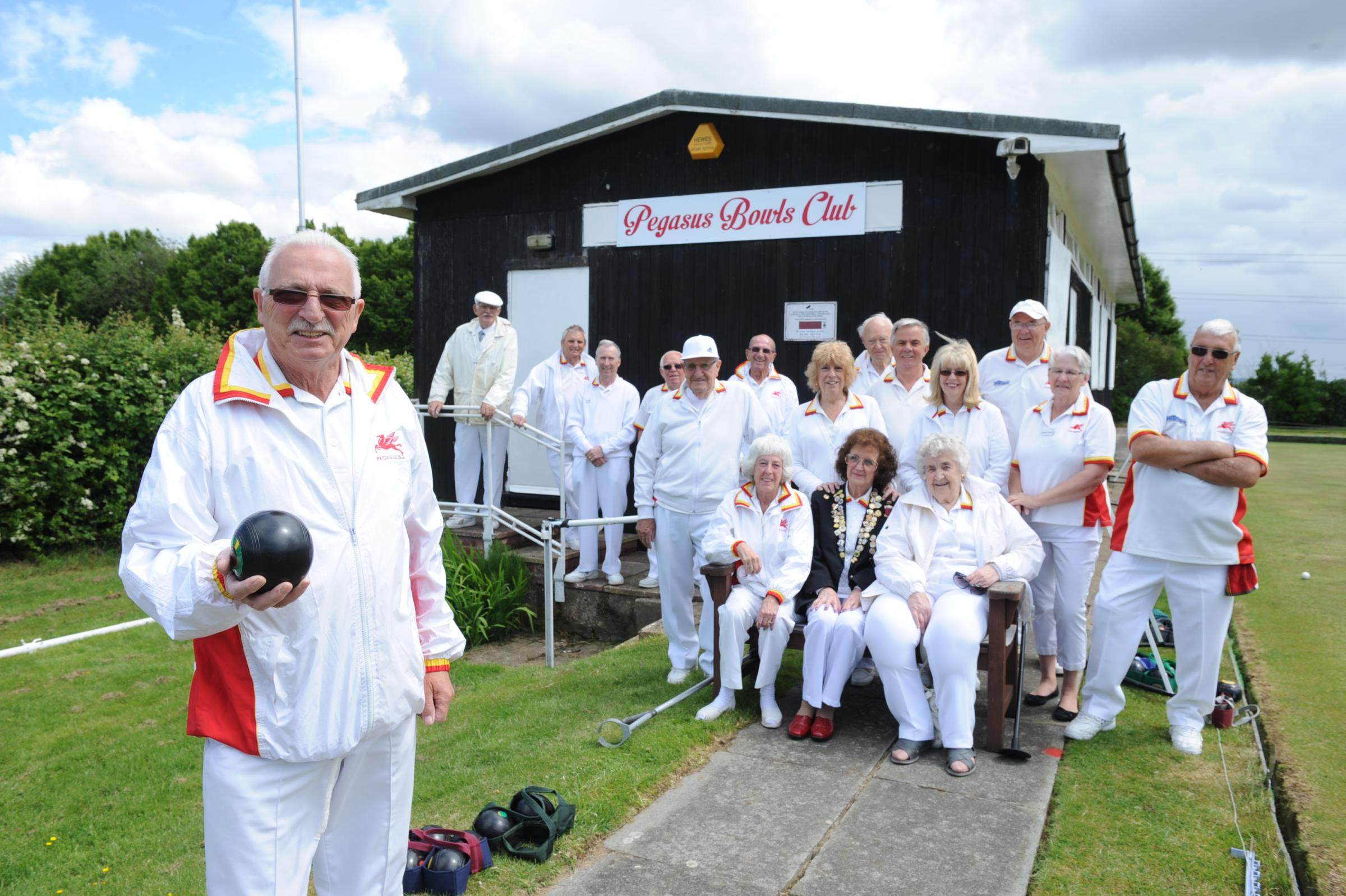 Bowled over – some of the members outside their new clubhouse