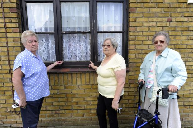 Echo: Concerned – Joan Stevenson, Bernie Cheesman and Lily Healy with one of the decaying windows Picture: ANNA LUKALA