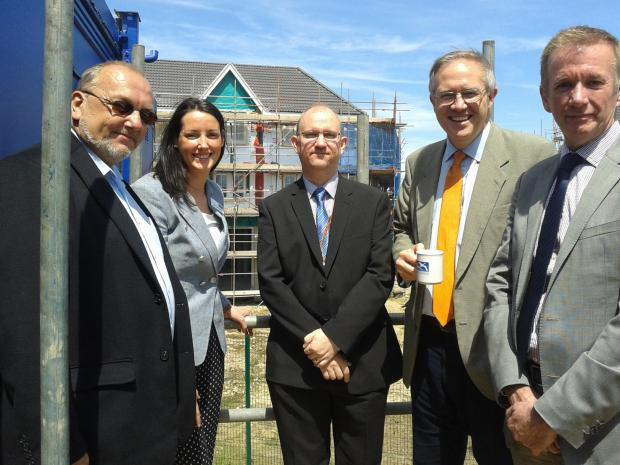 Toasting the success of the regeneration project – left to right, ex-council leader Tony Ball, Mary Gibbons, from Swan Housing, councillor David Sheppard, John Baron MP and Geoff Pearce, from Swan Housing