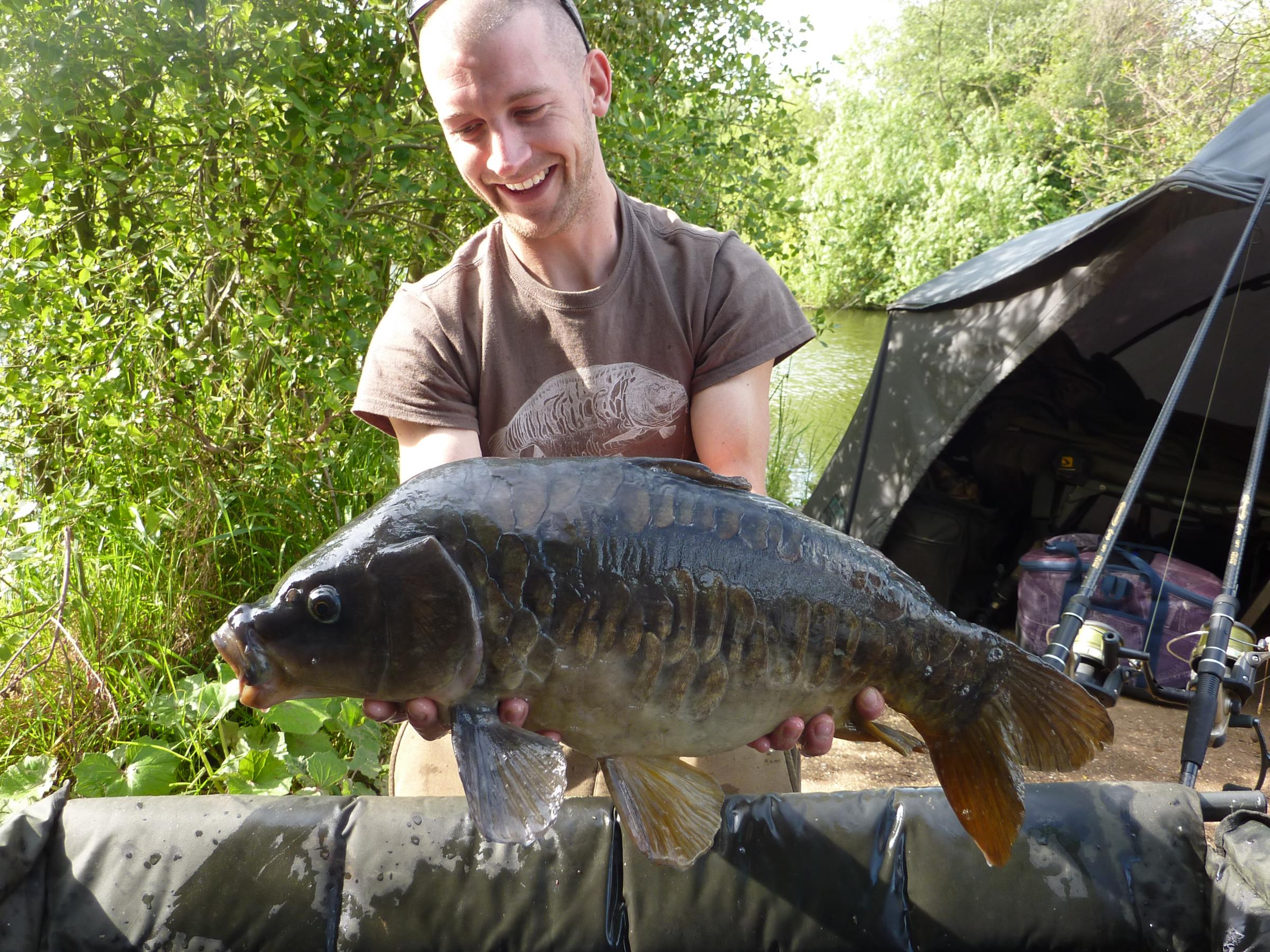 All smiles — Ed McIntosh and one of his carp