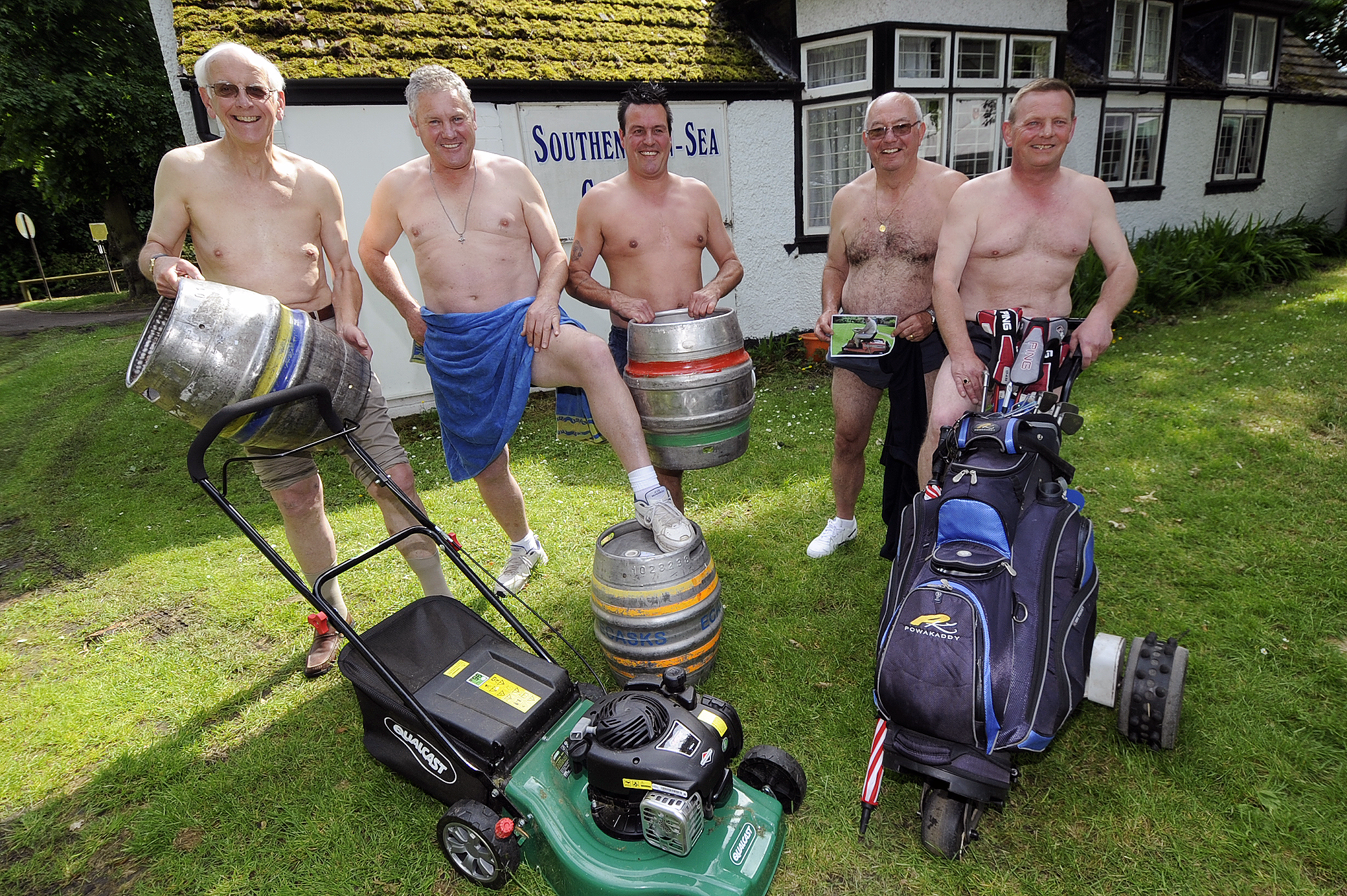 Stripping off - the golfers pose