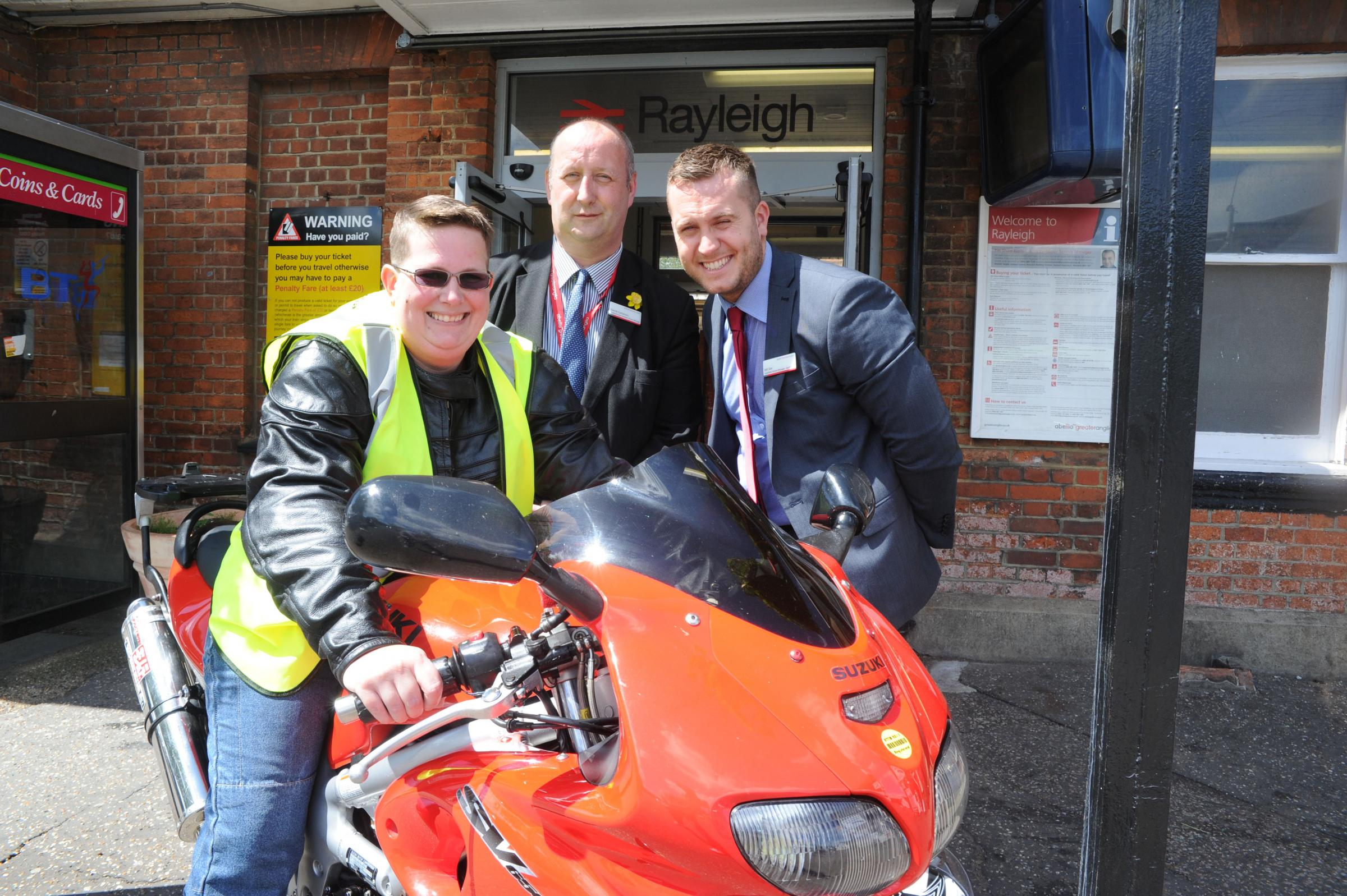 Ready to ride – Sarah Taylor, with Rayleigh station manager Dave Cameron and assistant manager and Bill Sier