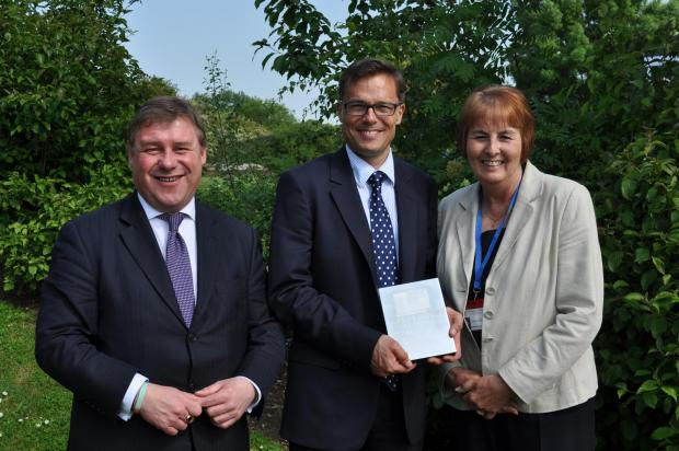 Top class – headteacher Andy Hodgkinson, centre, receives his award from MP Mark Francois and chairman of governors Lynda Walker