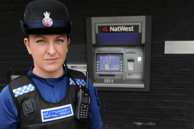 Card warning – PCSO Kelly Rowan at the cash machine targeted by villains