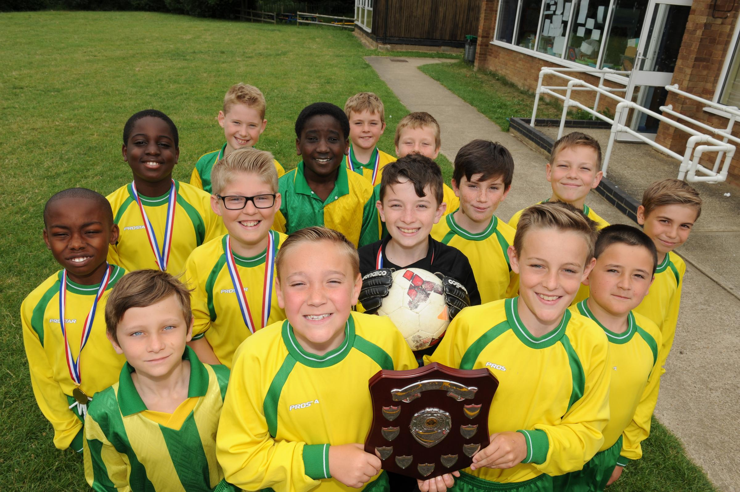 Champions – St Joseph's Catholic Primary School with their league winners' shield