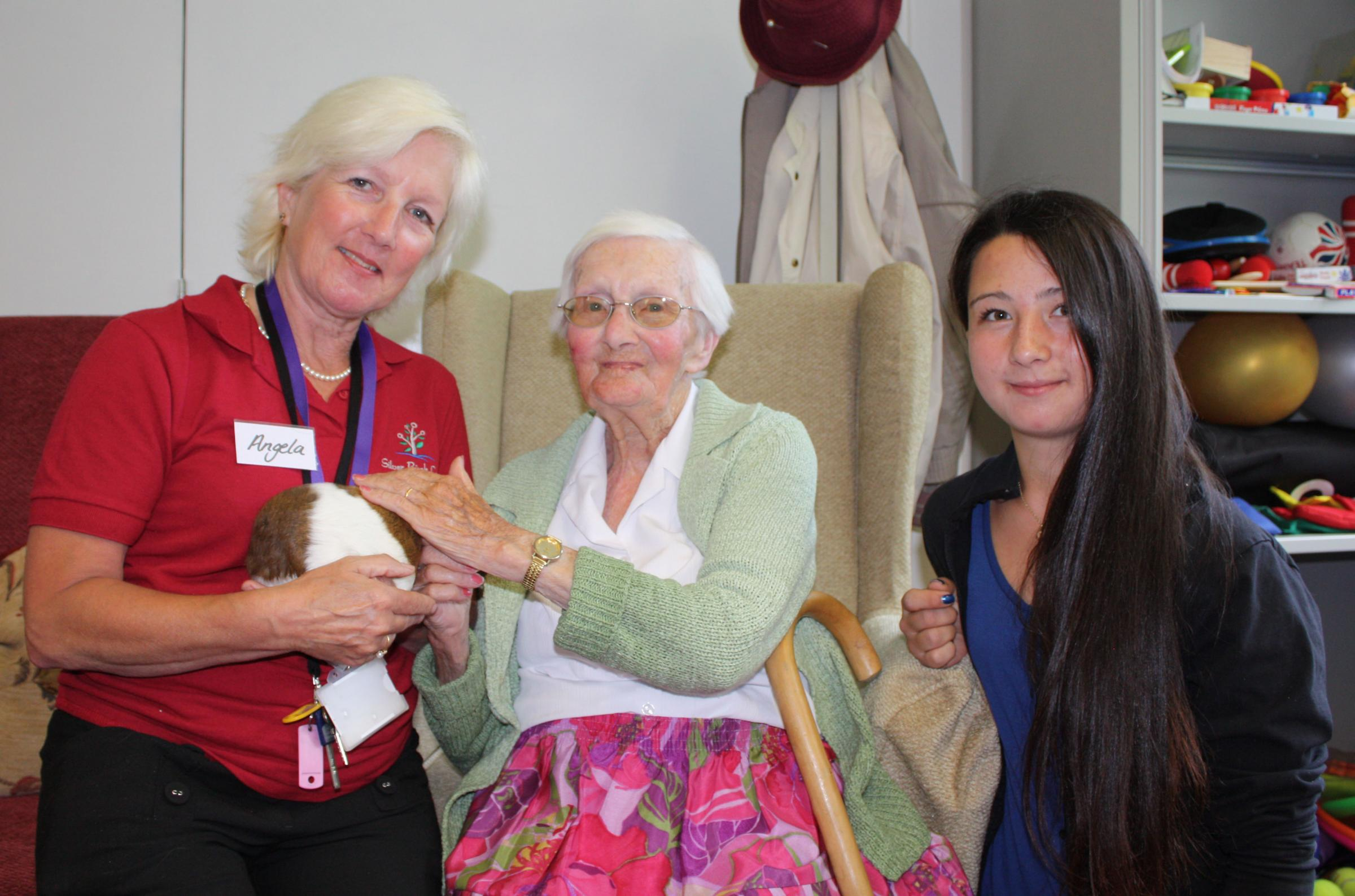 Animal magic as students visit dementia centre