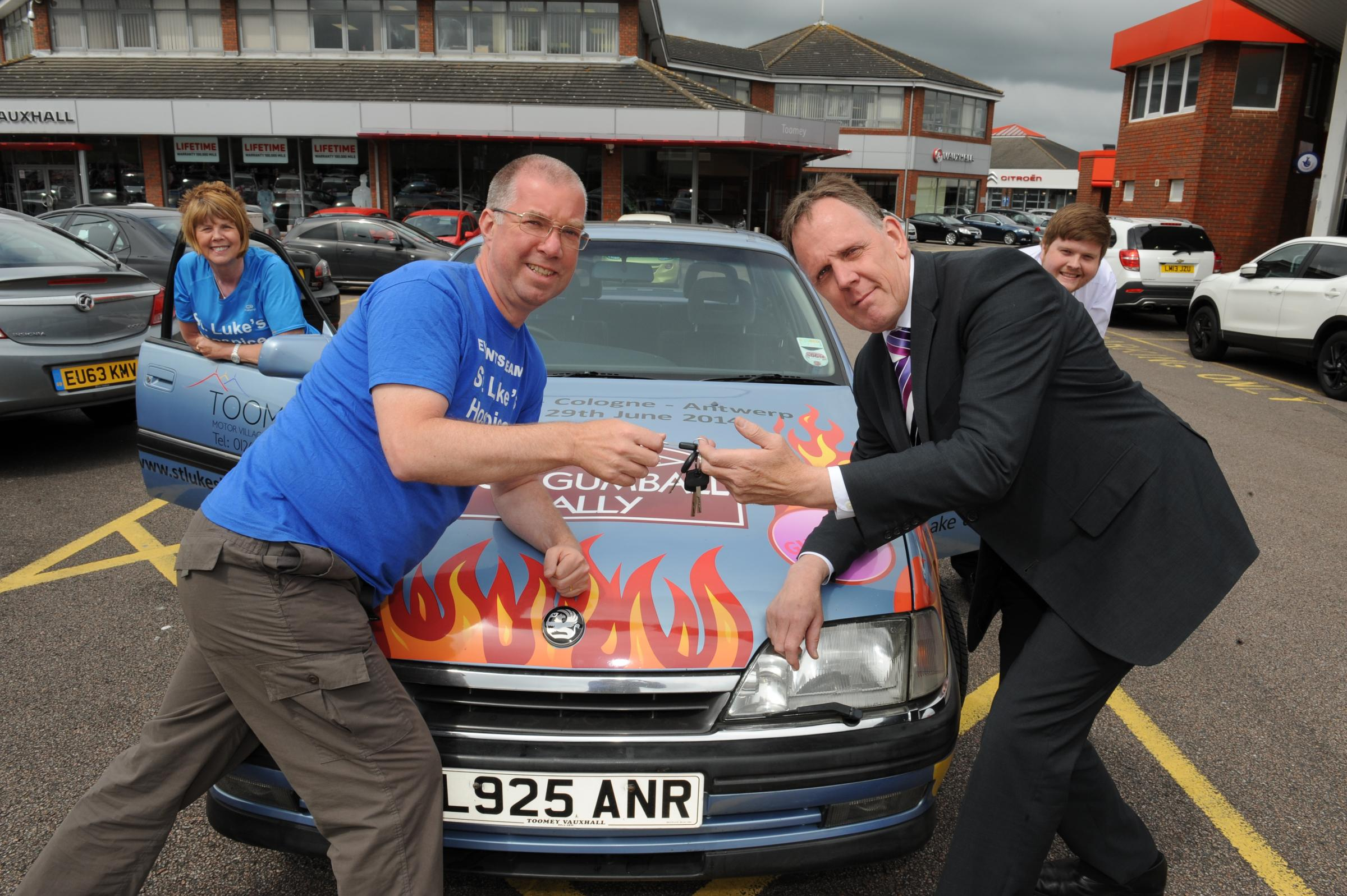 Charity rally – MD of Toomey Motor Village, in Basildon, Barry Ives hands the car keys over to Tony Bloomfield, from St Luke's Hospice