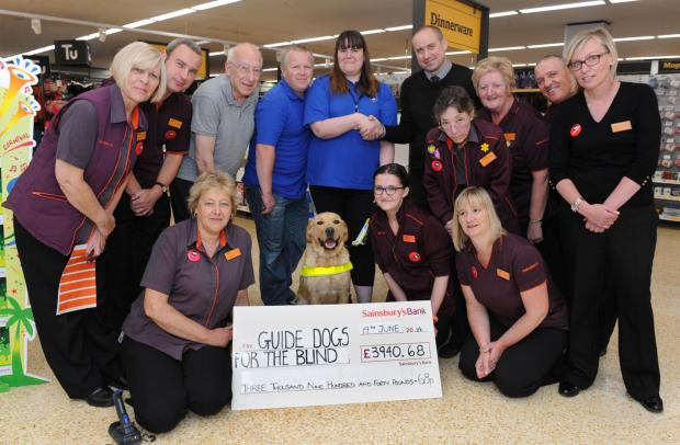 Store's year of fundraising for guide dogs