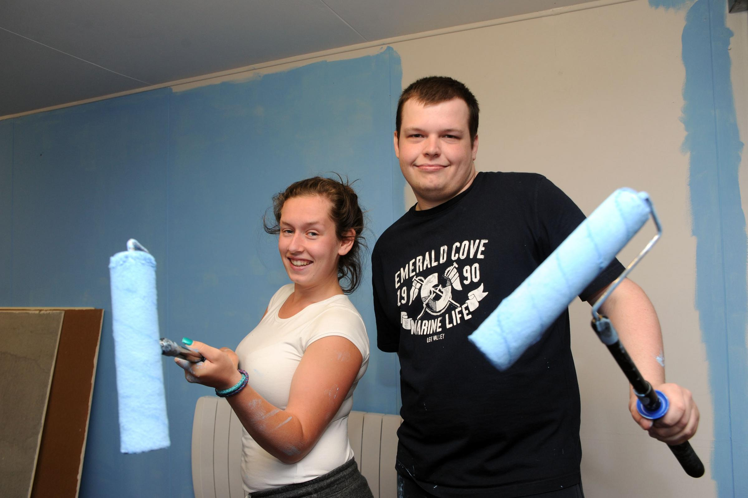 Charlie Collings and Matthew Galley applying a coat of paint at the day centre
