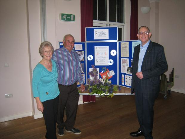 Final fundraiser - Inner Wheel president Jean Quarmby, Geoffrey Bradley with his flower arrangement and Eric Quarmby, from Talking Newspapers